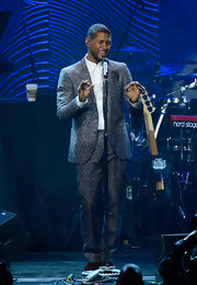 Usher rocked a silver, shiny suit while performing at the Clive Davis and Recording Academy pre-Grammy Gala.