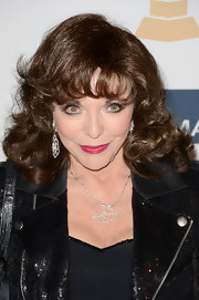 Joan Collins wore her signature brunette locks in bouncy curls a pre-Grammy event.