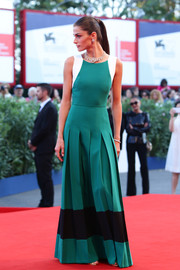 Elisa Sednaoui looked vibrant and elegant in this pleated tricolor gown by Fendi during the Venice Film Festival closing ceremony.