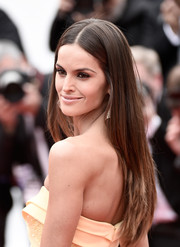 Izabel Goulart wore her hair long and straight with a center part during the Cannes closing ceremony.
