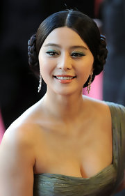 Fan Bingbing rocked braided side buns to Cannes Film Festival. A sleek center part completed her look.