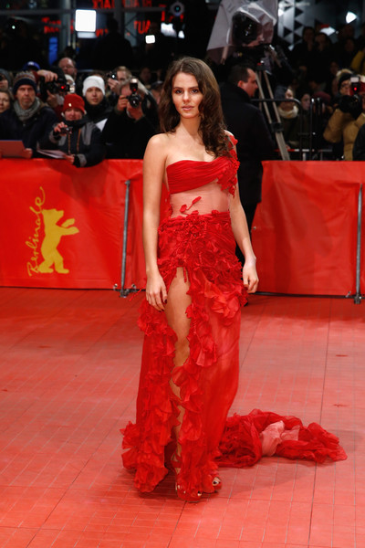 Ruby O. Fee hovered between spring goddess and seductive bombshell in a red ruffle one-shoulder gown with a sheer midriff and a hip-high slit during the BIFF closing ceremony.