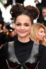 Sasha Lane attended the Cannes Film Festival closing ceremony rocking twin dreadlock buns.