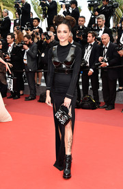 Sasha Lane was edgy at the Cannes Film Festival closing ceremony in a long-sleeve black Louis Vuitton dress with a corset overlay and double slits.