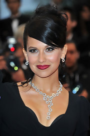 Hilaria Thomas swept her hair up into a stylish messy updo with sleek side-swept bangs.