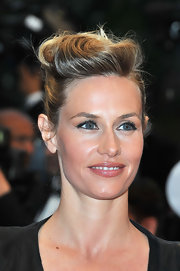 Cecile De France arrived for the closing ceremony of the Cannes Film Festival wearing her hair in a voluminous updo.