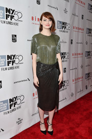 Emma Stone's slouchy Jason Wu outfit for the 52nd New York Film Festival featured a sequined olive green top and black knee length skirt.
