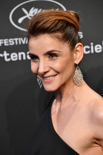 Clotilde Courau Diamond Chandelier Earrings [photo,hair,hairstyle,face,eyebrow,beauty,chin,ear,lip,blond,bun,clotilde courau,sidelines,cannes,french,chopard ``space,chopard party,party,cannes film festival,film festival]