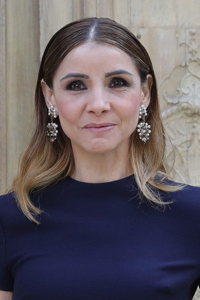 Clotilde Courau Dangling Pearl Earrings [valentino : outside photocall,hair,face,eyebrow,hairstyle,chin,beauty,forehead,blond,lip,hair accessory,valentino,clotilde courau,part,paris,france,paris fashion week womenswear spring,show]