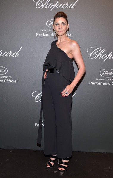Clotilde Courau Jumpsuit [beauty,fashion model,shoulder,flooring,formal wear,joint,fashion,carpet,little black dress,fashion design,caroline scheufele,clotilde courau,rihanna,chopard space party - photocall,cannes,france,port canto,chopard space party,chopard,cannes film festival]