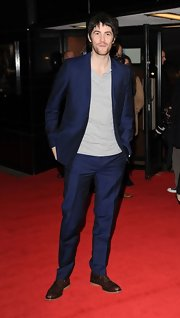 Jim Sturgess paired a knit top with a suit for a casual, but dressy look on the red carpet.