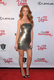 Cintia Dicker was all dolled up wearing a metallic mini dress at the Club SI Swimsuit event.