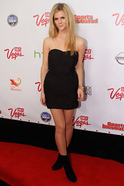 Brooklyn Decker balanced out her hyper-sexy lbd with black mid-calf boots.