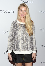 Whitney Port was edgy-casual in a zippered black mini skirt and a snakeskin-print sweater at the Club Tacori event.