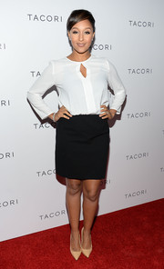 Tamera Mowry's black mini skirt and long-sleeve white blouse at the Club Tacori event were a very classy pairing.