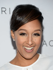Tamera Mowry pulled her hair up in a classic bun with side-swept bangs for the Club Tacori event.