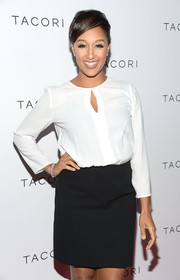Tamera Mowry went for a classic look with a white keyhole-neckline blouse and a black mini skirt at the Club Tacori event.