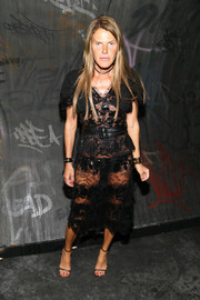 Anna dello Russo vamped it up in a sheer black lace dress at the Coach 1941 fashion show.