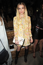 Emma Roberts teamed her frocked with black knee-high lace-up boots by Francesco Russo.