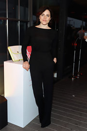 Antje Traue chose a fitted black top with a boat neckline for a chic all-black look.