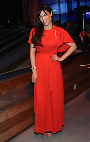 Paula Patton opted for a flowing red maxi with a cinched waist and butterfly sleeves.