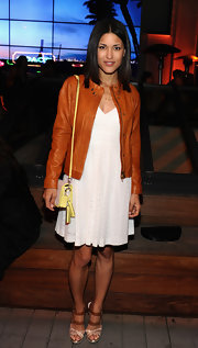 Julia Jones chose a classic leather jacket in a fun brown color for her casual look at Coach's benefit.