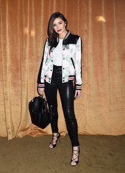 Olivia Culpo topped off her ensemble with a black leather backpack by Auxiliary For Aritzia.