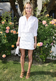 Kate Bosworth wore a floral-appliqued mini skirt with her top for a feminine touch.