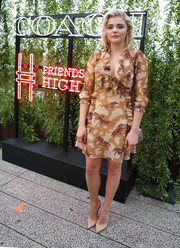 Chloe Grace paired her dress with nude ankle-strap pumps by Christian Louboutin.