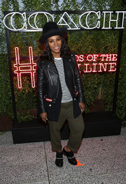June Ambrose sported a multilayered look, consisting of a black leather jacket, a blazer, and a striped shirt, at the Coach and Friends of the High Line Summer Party.