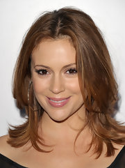 Alyssa Milano was all smiles at the Children's Defense Fund with layered shoulder length tresses.