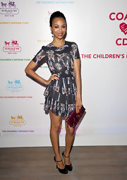 Zoe Saldana looked polished in black patent ankle strap pumps.