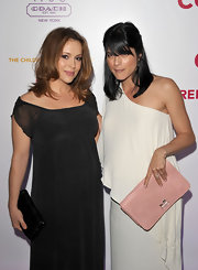 Alyssa Milano carried a petite black leather Kristin clutch.
