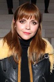 Christina Ricci wore her hair loose and straight with wispy bangs during the Coach fashion show.