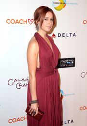 Ashley Tisdale went matchy-matchy with this burgundy polka-dot clutch and halter dress combo at the CoachArt Gala of Champions.