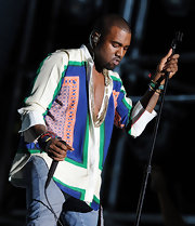 Kanye donned a colorful 60's print tunic for his performance at Coachella.