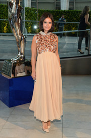 Miroslava Duma completed her beautiful outfit with a pair of nude PVC cap-toe pumps.