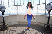 Coco Jones paired her colorful ensemble with a chic pair of blue ballet flats when she visited the Empire State Building.