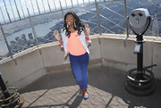 Coco Jones sported this gray blazer with orange trim for a trendy and youthful look while visiting the Empire State Building.