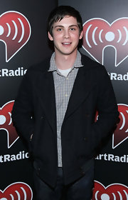 Logan Lerman finished off his ensemble in classic style with a black pea coat at the iHeartRadio concert.