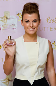 Coleen Rooney showed off her high bun while launching her new fragrance Butterflies.