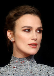 Keira Knightley styled her hair into a braided updo for the UK premiere of 'Colette.'