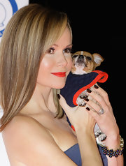 Amanda Holden sported bright coral-red lips at the Collars & Coats Gala Ball.
