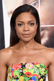 Naomie Harris totally embraced color, teaming her floral outfit with blue eyeshadow.