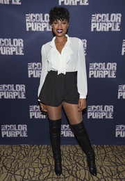 Jennifer Hudson kept it classic up top in a long-sleeve white ruffle blouse during the 'Color Purple' Broadway cast photocall.