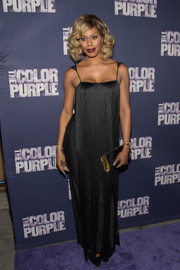 Laverne Cox went for 1920s glamour in a fringed black gown by Tom Ford during the Broadway opening of 'The Color Purple.'