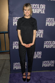 Taylor Schilling complemented her jumpsuit with black Mary Jane pumps.