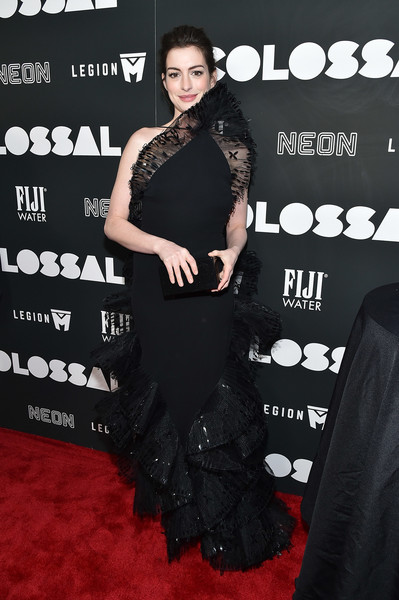Anne Hathaway got majorly frilled up in a black Armani Privé halter gown with lace ruffle accents for the New York premiere of 'Colossal.'