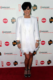 Kris Jenner paired her white blazer with an arm full of decadent bangles.