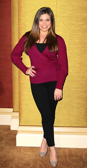 Danielle wore a bright cranberry sweater with skinny black pants.